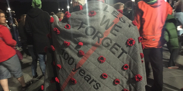 To commemorate 100 years of ANZAC, Wellington resident Fay McGregor took an old army blanket and attached poppies. Photo / Solbin Kang