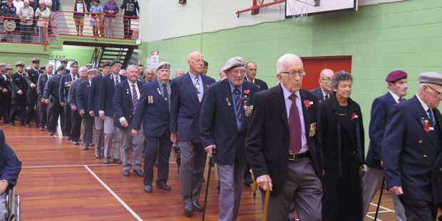 Returned Servicemen and women march into the Whakatane Memorial Hall. Photo/Katee Shanks