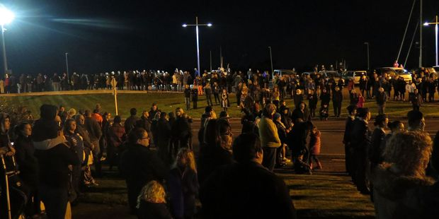 Crowds gather beside the Whakatane River for the Dawn Service. Photo/Katee Shanks