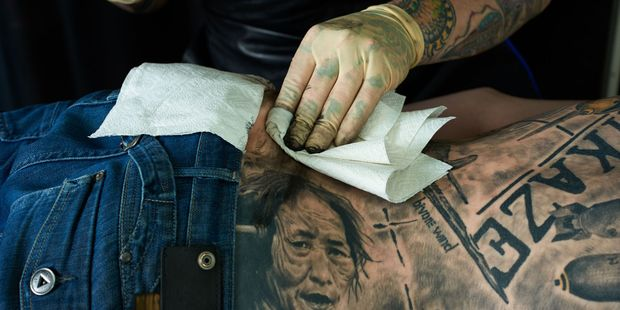 Do your research before getting a tattoo while travelling.  Photo / 123RF