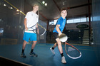 Ben Grindrod, left, and Jamie Oakley inside the impressive glass squash court at Tauranga Boys' College. Photo / Andrew Warner