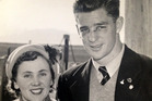 Des White, with his wife in 1952, says Jim Amos was a player's coach.