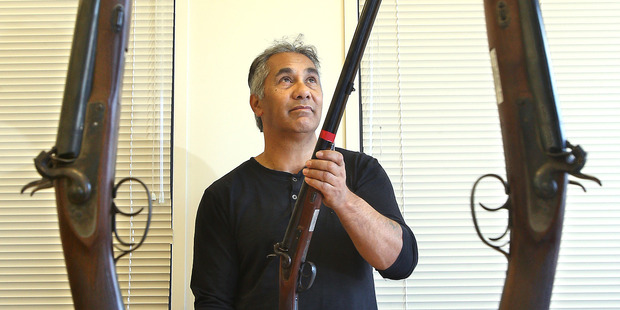 Loading Dean Flavell with pukahinahina shotguns for sale - replica shotguns used for the 150 year Gate Pa commemorations are up for sale. Photo/John Borren