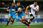 Rieko Ioane of the Blues makes a break to score a try during the round eight Super Rugby match between the Blues and the Sharks. Photo / Getty Images