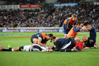 Willie Le Roux of the Sharks and Jason Emery of the Highlanders. Photo / Getty Images