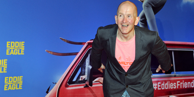 British ski jumper Eddie 'The Eagle' Edwards poses as he arrives for a special screening of 'Eddie The Eagle' in Munich, Germany. Photo / AP