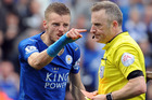 Leicester City's Jamie Vardy gestures to referee Jonathan Moss after being given a second yellow card and sent off. Photo / AP.
