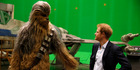 Prince Harry meets Chewbacca on the Pinewood set. Photo / AP