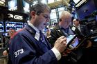 Trader John Panin, left, works on the floor of the New York Stock Exchange. File photo / AP