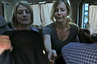 Australian TV journalist Tara Brown, left, and Sally Faulkner, right, the mother of the two Australian children, sit in a minivan after they released from a Lebanese jail. Photo / AP