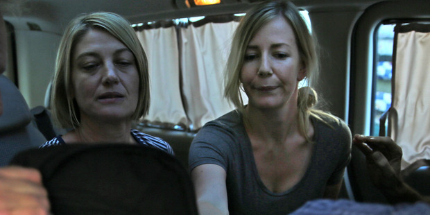 Loading Australian TV journalist Tara Brown, left, and Sally Faulkner, right, after they were released from a Lebanese jail with the three members of Channel 9 crew. Photo / Hussein Malla