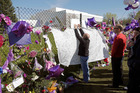 Fans pay tribute at the memorial fence outside Paisley Park - which is set to become a museum. Photo / AP