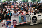 Relatives of the 43 missing students listen to the international experts group's report, in Mexico City. Photo / AP