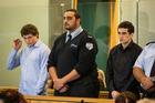 Leonard Nattrass-Berquist, left, and Beauen Wallace-Loretz, right, stand in the dock at the High Court at Auckland during their trial for the murder of Ihaia Gillman-Harris. Photo / Greg Bowker
