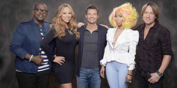 American Idol host Ryan Seacrestis flanked by 2013 troubled judges Randy Jackson, Mariah Carey, Nicki Minaj and Keith Urban