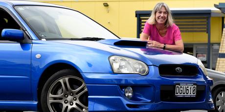Tauranga Girls' College's deputy principal Leonie Summerville and her 'boy racer' car. Photo/George Novak