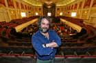 Director Sir Peter Jackson poses in front of the New Zealand Symphony Orchestra. Photo / Hagen Hopkins