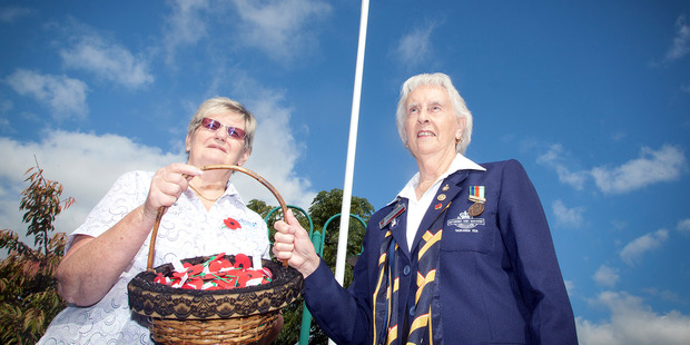 Tauranga RSA president Heather Waldron and Faye Cairns, a therapist at Radius Care, dedicate a flag pole at the Althorp Village hospital in Pyes Pa prior to the village's annual Anzac Day service