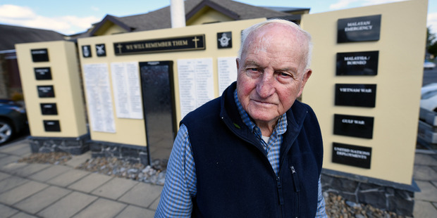 Army veteran Bob Swale, 90, stands at the Tauranga RSA's Remembrance Wall. The wall includes names of local service members who died in the First and Second World Wars.