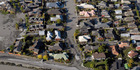 Aerial view of liquefaction and earthquake damaged houses in Burwood, Christchurch.