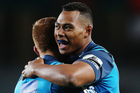 Blues first-five Ihaia West congratulates Tevita Li on his try against the Rebels at Eden Park last night. Photo / Getty Images