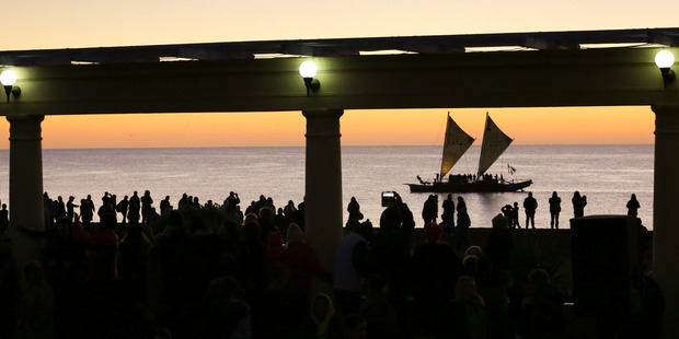 The waka Te Matau A Maui came close to shore and delivered a traditional salute as the Napier service came to a close. Photo / Warren Buckland