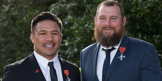 Loading Former All Blacks Keven Mealamu and Tony Woodcock, after receiving the Insignia of a Member of the New Zealand Order of Merit. Photo / Brett Phibbs
