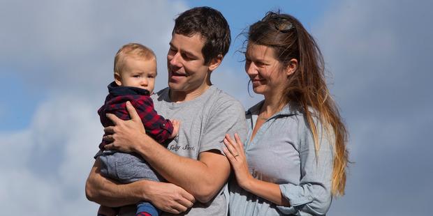 Loading Peter Redmond, with Kit, 8 months, and fiancee Anna. Photo / Brett Phibbs