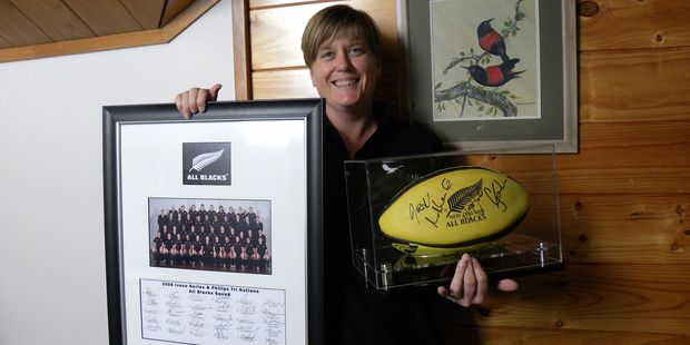 Pukaha general manager Helen Tickner with All Blacks memorabilia that will be auctioned at a fundraising dinner on Friday. PHOTO/SUPPLIED