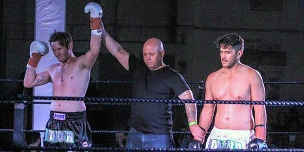 Masterton kickboxer Matt Gain, left, pictured at Honour 7 earlier this month, won his second fight at Whanganui on Saturday night. PHOTO/FACEBOOK