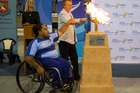 Te Kopa Kopa and Nicki Turner lights the flame to officially open the Halberg Junior Disability Games in Cambridge. PICTURE/SUPPLIED