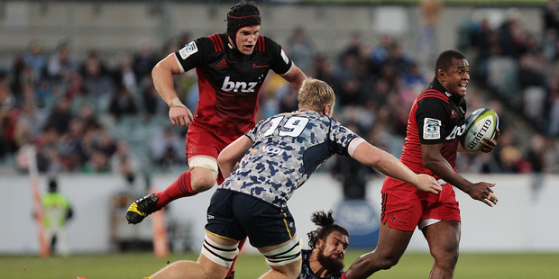 Crusaders Matt Todd (L) and Jone Macilai (R) were instrumental during their team's destruction of the Brumbies at GIO Stadium. Photo / Getty