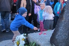 Nat Edhouse, 4, lays a poppy at Waihi's dawn service today. Photo/Melanie Camoin
