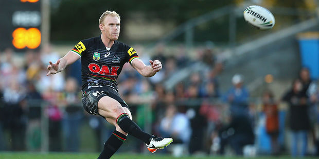 Penrith's Peter Wallace kicks a game winning field goal against the Canberra Raiders. Photo / Getty