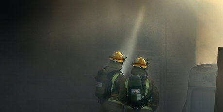 Firefighters trying to control the fire at a home in Te Puke. Photo/John Borren