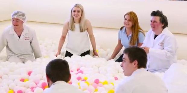 Staff at Swizzels enjoy taking a break in the adult ball pit.