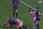 Storm skipper Cameron Smith touches referee during their game against the Warriors. Photo / Fox Sport