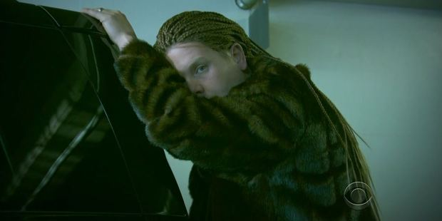 Just like Beyonce, James models cornrows and a furry jacket in one parody scene.