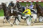 Dexter Dunn drives Field Marshal (4) to victory in the $100,000 Messenger at Alexandra Park. Photo / Greg Bowker