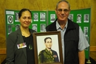 Major William Porter's granddaughter Melissa Peehikuru and son Jim Porter, both of Auckland, with a portrait of their heroic forebear. Photo / Peter de Graaf