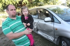 Masterton teacher Paul Andersen with his 2-year-old daughter Hana. Mr Andersen has been fighting a three-month insurance battle with Ace Rental Cars after a tourist drove into the side of his family car.Photo/Andrew Bonallack