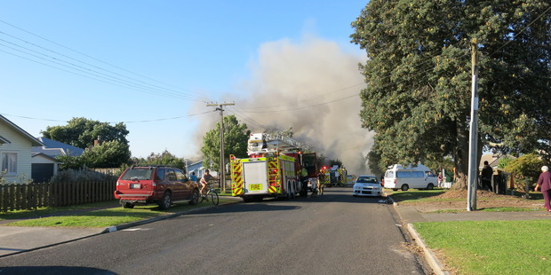 Firefighters arrive at Harris St, Te Puke, where a house is on fire. Photo/Pauline Carney