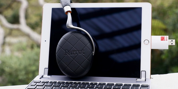 The iPad Pro 9.7-inch mounted on the BrydgeAir keyboard, with Parrot Zik 3 earphones, and a Strontium iDrive plugged in. Photo / Supplied