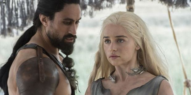 Joe Naufahu as Khal Moro and Emilia Clarke as Daenerys Targaryen.