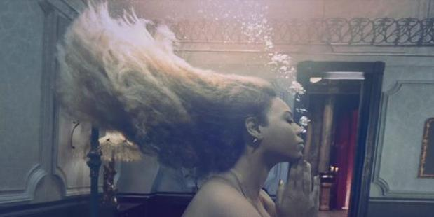 Beyonce swims underwater in one scene from her Lemonade music video. Photo / HBO