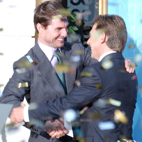 Tom Cruise embraces Scientology leader David Miscavige at the official opening of a new church in Madrid in 2004. Photo / AP