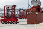 Fully automated AutoStrads pick up shipping containers to be moved at the TraPac shipping terminal in the Port of Los Angeles. Photo / Bloomberg