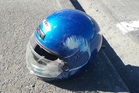 The rider's helmet was wedged between the ground and the vehicle's axle.