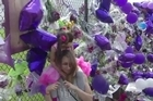 Prince fans in are flocking to the music superstar's home leaving purple flowers and balloons along the fence of the compound, called Paisley Park.