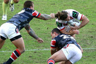 Mitch Rein of the Dragons has his hair pulled in an attempted tackle by Jake Friend of the Roosters. Photo / Getty